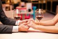 Dating man and women at the restaurant holding hands together Royalty Free Stock Photography