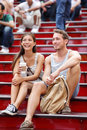 Dating multiracial tourist couple in new york city manhattan on the red stairs and steps on times square happy multiethnic young Royalty Free Stock Images