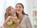 Daughter congratulates mom Royalty Free Stock Photo
