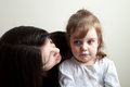 Daughter getting talked to toddler age girl spoken by her mother great parenting concept image Stock Photography