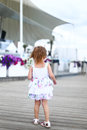 Daughter girl baby famale child is coming back from us kid walk walking summer nature childre dress hair sandals footwear flowers Royalty Free Stock Images