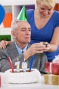 Daughter gives father gift for birthday th Stock Image