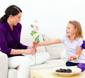 Daughter giving flowers to mother Royalty Free Stock Images