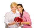 Daughter giving gift to her mother Stock Photography