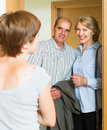 Daughter greeting parents at threshold adult elderly Stock Photos