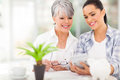 Daughter helping mother calculate happy middle aged her retirement investments Stock Images
