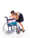 Daughter hugging disabled mother Stock Photography
