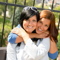 Daughter hugging her mother outdoors happy loving Stock Photos