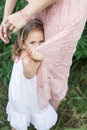 Daughter hugs mother, family photosession in flowers
