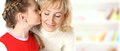 Daughter kiss her mother on a white background Royalty Free Stock Photo
