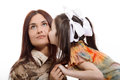 Daughter kisses her mother on white background Stock Images