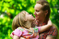 Daughter kissing her mum Stock Photography