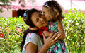 Daughter kissing mother. Royalty Free Stock Photo