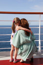 Daughter and mother embracing on cruise liner deck Royalty Free Stock Image