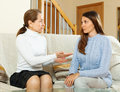 Daughter and mother having serious talking teenager in home interior Stock Images