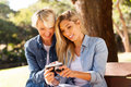 Daughter mother viewing photos cheerful and middle aged on digital camera Royalty Free Stock Photography