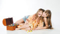Daughter and mother woman with a little girl lying on the floor hugging laughing Stock Photo