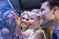 Daughter touching a starfish tank Royalty Free Stock Photo