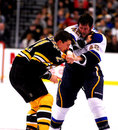 David Backes punches Andrew Ference Stock Image
