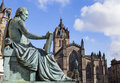 David Hume Statue and St Giles Cathedral in Edinburgh Royalty Free Stock Photo