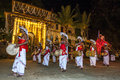 Davul players davulkaruwo perform past the temple of the sacred tooth relic complex in kandy sri lanka esala perahera is held Royalty Free Stock Photo