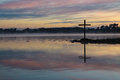 Dawn lake cross at a with wonderful morning sky colors Stock Photo
