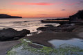 Dawn skies at malabar with rockpool Royalty Free Stock Images