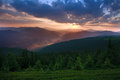 Dawn sun rise early morning with gray clouds in mountain valley Royalty Free Stock Photo