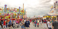 A day at the carnival people wandering through amusement rides in spin city wisconsin state fair Royalty Free Stock Photography