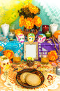 Day of the dead altar dia de muertos traditional mexican with blank photo frame sugar skulls cempasuchil flowers candles and Royalty Free Stock Photos