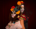 Day of the dead friends in colorful costumes and make up posing back to back Royalty Free Stock Photo