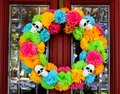 Day of the Dead wreath on door with tree and neighborhood reflected in beveled glass window Royalty Free Stock Photo
