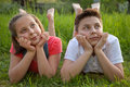 Day dreaming boy and girl portrait of a young on a meadow Stock Photography