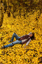 Day Dreaming in Fall Leaves Royalty Free Stock Photo
