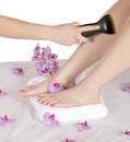 Day spa hair removal by masseuse on leg therapy business is using laser to remove unwanted from the of a client while resting Stock Image