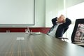 Daydreaming middle aged businessman in the office Royalty Free Stock Photo
