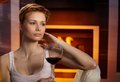 Daydreaming woman with glass of wine Royalty Free Stock Photo