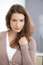 Daydreaming woman standing at wall Stock Images