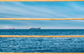 Daytime landscape with ships and ropes in the port in the foreground Royalty Free Stock Image