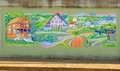 Dazzling Mural of Houses In A Hillside Community On A Bridge Underpass on James Road in Memphis, Tennessee. Royalty Free Stock Photo