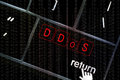 Ddos concept with the focus on the return button overlayed with distributed denial of service overlaid binary code Stock Image