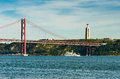 De abril bridge lisbon the is a suspension connecting the city of to the municipality of almada over tejo river Royalty Free Stock Photography