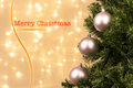 De focused lights with tree and merry christmas sign Stock Photos