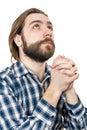 De jonge man met een baard bidt aan god Stock Afbeelding