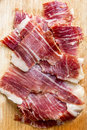 De spaanse ibericoham snijdt close up Stock Foto's