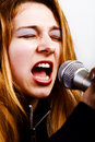 De zanger van de rock - vrouw met microfoon Royalty-vrije Stock Foto