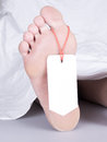 Dead body with toe tag Royalty Free Stock Photos