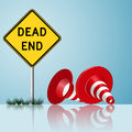 Dead end sign with cones and grass Royalty Free Stock Photos