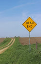 Dead end sign on dirt road in the country Royalty Free Stock Image