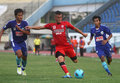 Dead footballer diego mendieta persis solo players mandieta center tries to kick overshadowed two players persitara in advanced Stock Photography